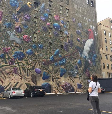 Nikki Villagomez Looking at Local Mural Work